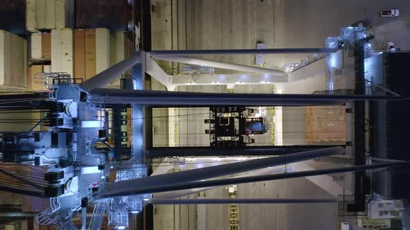 Thumbnail for Top View Over the Working Mechanism of Loading Crane in Port Miami Docks at Night