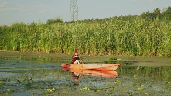Thumbnail for Woman is paddling in kayak on river in summer.