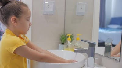 Concept Handwashing. Little Girl or Child Washes Hands with Soap, Hands Washing To Prevention