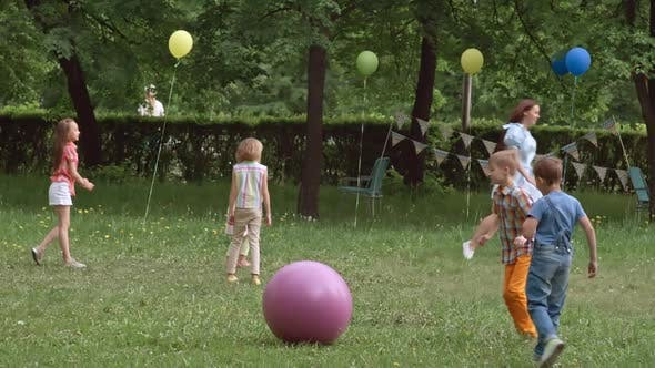 Thumbnail for Kids Playing with Toy Balls at the Outdoor Party