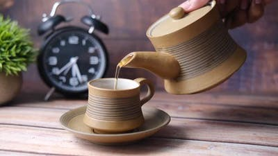 Pouring Tea From a Tea Ceremony Top Down