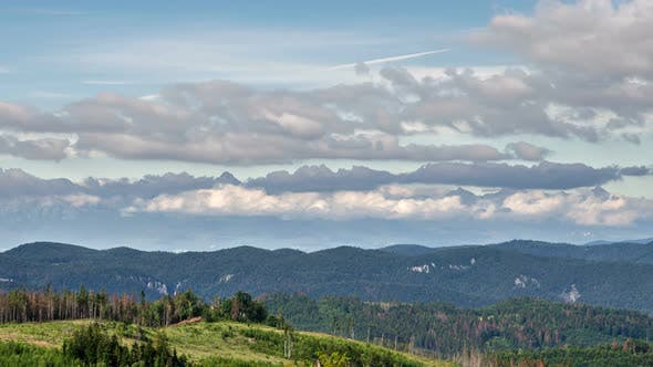 Cloudy Sky in Mountains over Forest Country Nature
