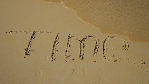 Inschrift im Sand