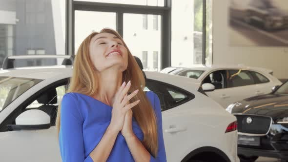 Thumbnail for Gorgeous Excited Woman Celebrating Buying New Car at the Dealership