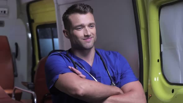 Thumbnail for Pleased Corpsman Stand on the Background of Ambulance Car