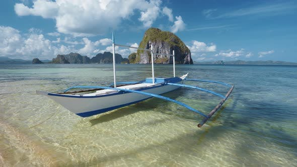 Tourist Banca Boat Float in Morning Light Ready for Island Hopping Trip. Nature Scene of El Nido