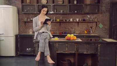 Female with Modern Device Spends Morning in Flat