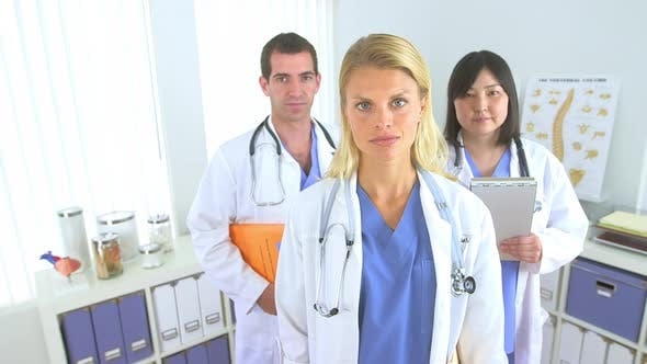 Thumbnail for Team of highly skilled doctors standing in the office