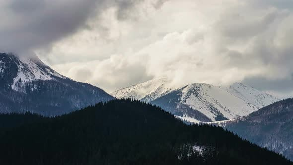 Thumbnail for Dramatic Clouds in Snowy Alpine Mountains