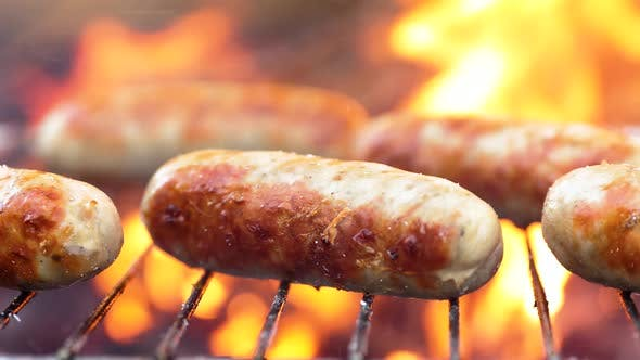 Cover Image for Delicious Juicy Sausages, Cooked on the Grill with a Fire