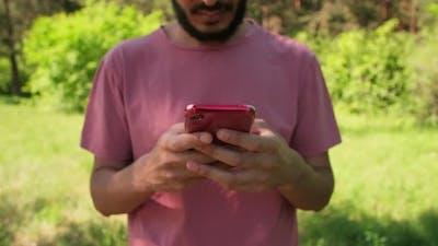 Unrecognizable Man Texting Message