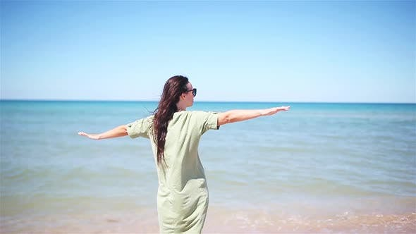 Thumbnail for Young Beautiful Woman Having Fun on Tropical Seashore. Happy Girl Background the Blue Sky and