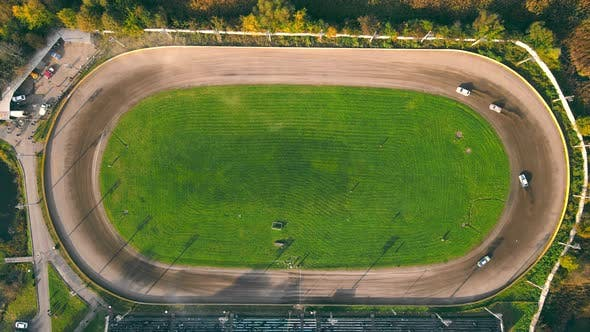 Thumbnail for Aerial View on Top Races on the Racetrack. Cars Driving in a Circle Drifting Around Corners Compete