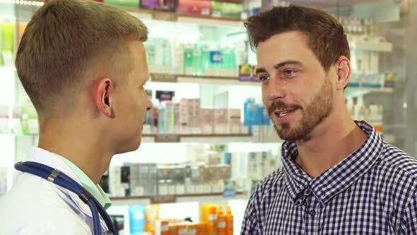 Thumbnail for Patient Talking To Doctor and Laughing at Drugstore