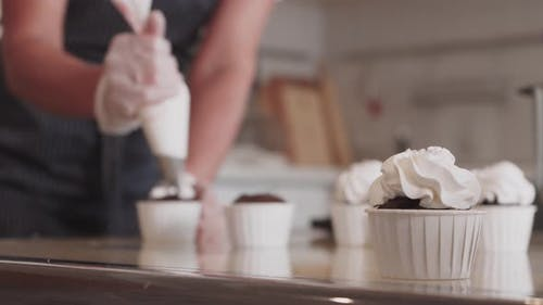 Decorating Handmade Cupcake with Vanilla Cream