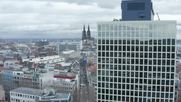 AERIAL: Wide Shot of Cologne Germany From the Air with Majestic Cathedral and Office Building in the