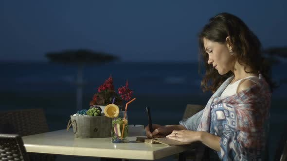 Thumbnail for Happy Young Woman Finishes Writing Romantic Memories in Diary Relax at Seaside