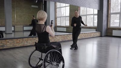 Disabled Woman Shooting Live Stream of Ball Dance