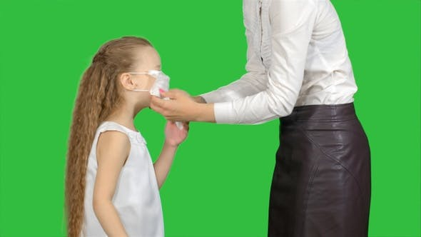 Thumbnail for Mother and daughter wearing surgical masks to protect