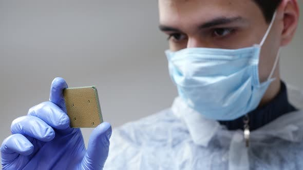 Thumbnail for Engineer Holding Microchip with Gloves and Examine It