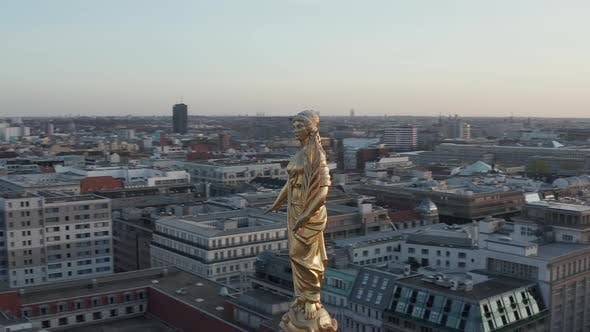 AERIAL: Golden Statue, Sculpture Close Up on Church Cathedral Rooftop in Berlin, Germany