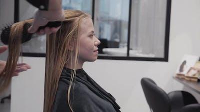 Hairdresser Brushing Woman'S Wet Hair