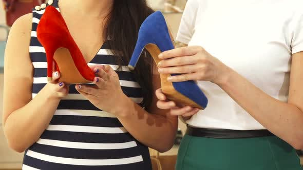 Thumbnail for Women Examining Different Shoes Close Up
