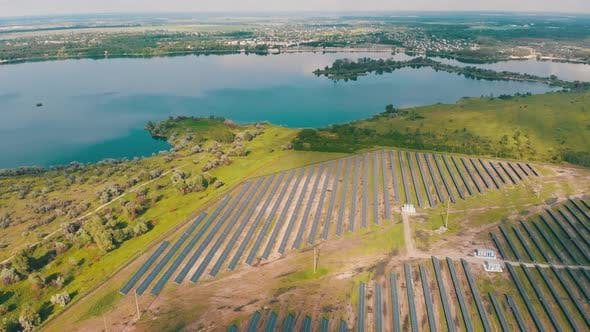 Thumbnail for Aerial View on Solar Power Station in Green Field Near River at Sunny Day