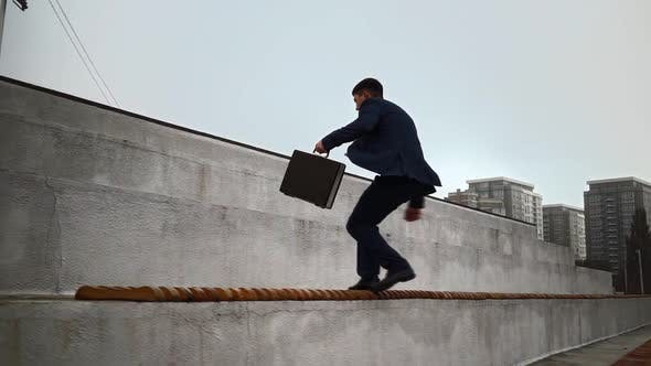 Businessman in Suit Jumps Up Parapets. Career Stairs Concept Corporate Promotion