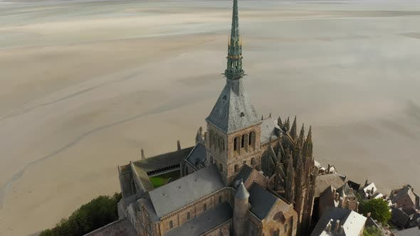 Mont Saint Michel Castle Top Big Cathedral Build in Ocean in France, Aerial Tilt Down