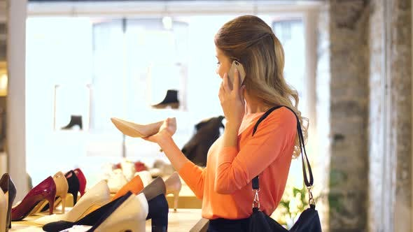 Thumbnail for Young Woman Calling on Smartphone at Shoe Store