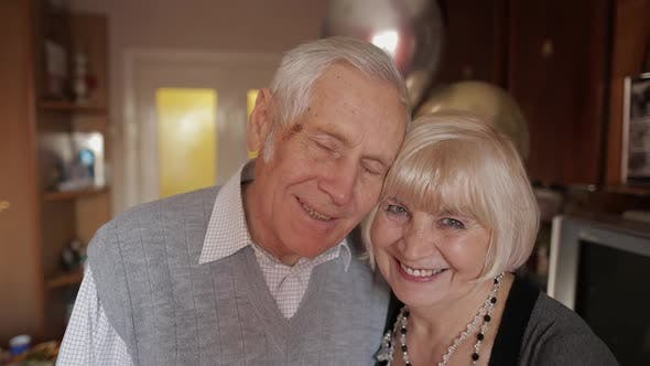 Thumbnail for Portrait of a Happy Grandfather and Grandmother Who Smiling Looks at Camera