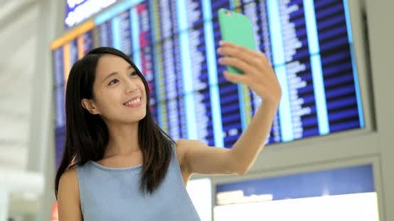 Thumbnail for Woman Taking Selfie with Cellphone at Airport