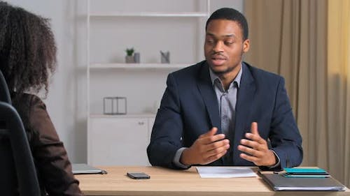 Afro American Business Man in Formal Suit Being Interviewed in Modern IT Marketing Company Sitting