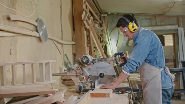 Thumbnail for Carpenter Working with Bandsaw in Workshop