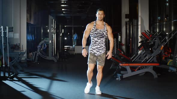 Cover Image for Athletic Man Workout and Trains Legs Joins and Knees Circle Exercises