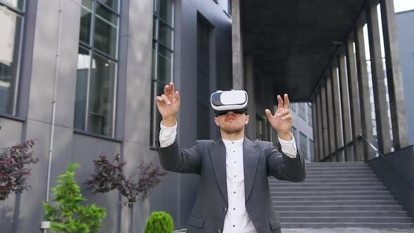 Thumbnail for Young Male Office Worker in Virtual Reality Headset Working on Imaginary Screen