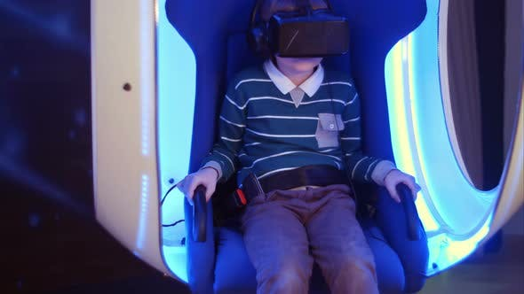 Thumbnail for Excited Boy Enjoying Virtual Reality Attraction