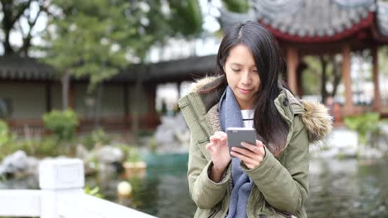 Thumbnail for Woman use of mobile phone in china at winter time