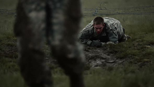 Thumbnail for Soldiers crawling under low barbed wire