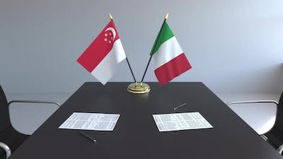 Flags of Singapore and Italy on the Table