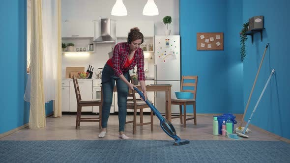 Thumbnail for Housewife Cleans the Carpet with a Vacuum Cleaner.