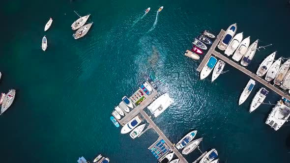 Flight Over a Dock with a Lot of Yachts and Boats  Shooting From a Drone