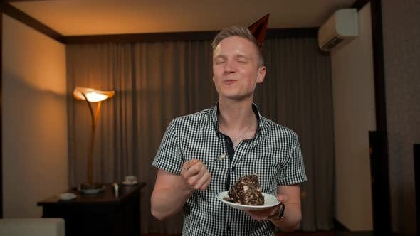 Thumbnail for Young Man Tasting and Eating Portion Piece of Birthday Cake