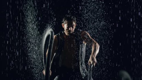 Athletic Man Working Out In The Rain