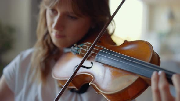 Thumbnail for Girl Playing Violin at Home. Violinist Playing Chords on Musical Instrument