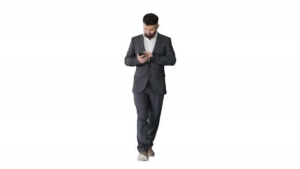 Thumbnail for Businessman Walking and Using the Phone on White Background.