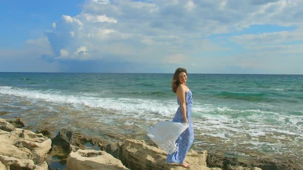 Thumbnail for Beautiful Brunette Woman in Maxi Dress Enjoying Windy Day on Seashore, Vacation
