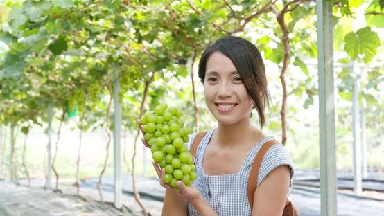 Thumbnail for Woman holding green grape
