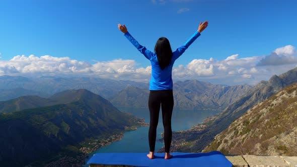 Thumbnail for Back View Woman Yogi Raising Hand in Mountain Area